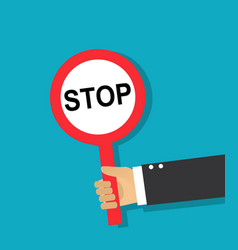 Hand holds a round stop sign vector