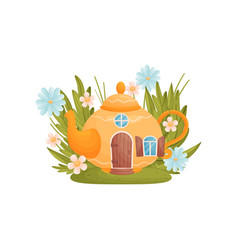 Fabulous house in form a teapot among grass vector