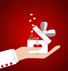 Happy valentines day Hand with Valentines day gift vector image vector image