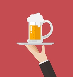 Waiter serving a glass of beer vector