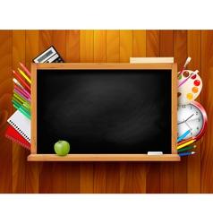 Blackboard with school supplies on wooden vector image