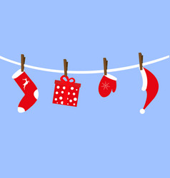 Santa claus accessories hang on clothespins vector