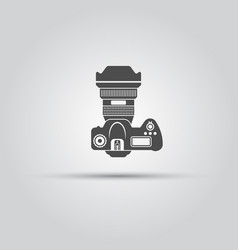 Photo camera top view isolated black icon vector