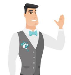 Young caucasian groom waving his hand vector