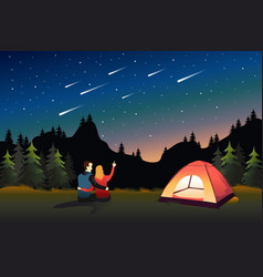 couple watching meteor shower while camping vector image
