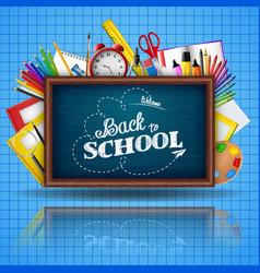 school supplies and blue blackboard vector image