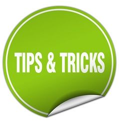 Tips tricks round green sticker isolated on white vector