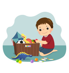 boy putting his toys into box vector image