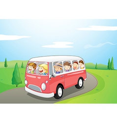 Little children riding in a bus vector