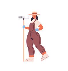 female farmer in uniform holding rake eco farming vector image