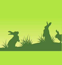 on green backgrounds easter bunny silhouettes vector image vector image