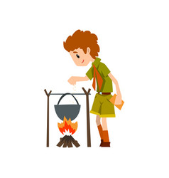 Boy scout character in uniform cooking food in the vector