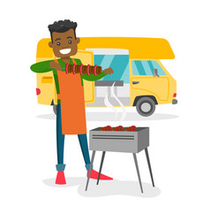 young man barbecuing meat in front of camper van vector image