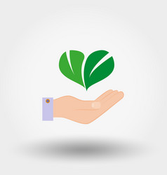 green leaves in the form of heart on hand vector image