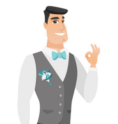 Young caucasian groom showing ok sign vector