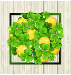 clover leaves and golden coins vector image