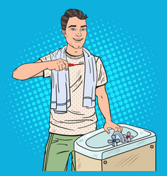 pop art man brushing teeth in bathroom vector image vector image