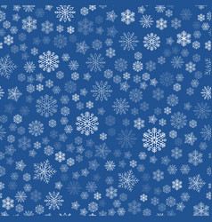 seamless texture of white snowflakes on a blue vector image
