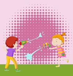 Boy and girl playing with water gun vector image