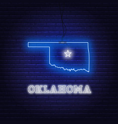 Neon map state oklahoma on a brick wall vector