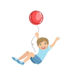 Boy hanging on big red balloon vector
