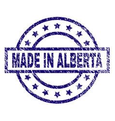 Grunge textured made in alberta stamp seal vector