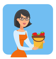 woman holding bucket strawberries poster vector image