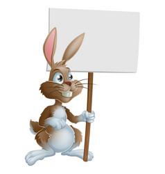 rabbit holding sign cartoon vector image vector image