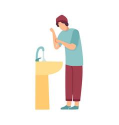 Muslim man washing hands preparing wudhu vector