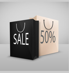 two shopping bags with written sale vector image