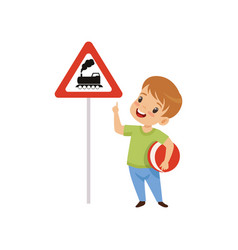 cute boy pointing finger at triangle road sign vector image