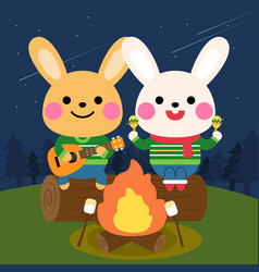 rabbits play music in front campfire vector image