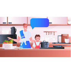 young father cooking with little daughter vector image
