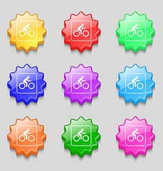 Cyclist icon sign symbol on nine wavy colourful vector