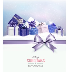 Merry Christmas card with a ribbon and gift boxes vector image