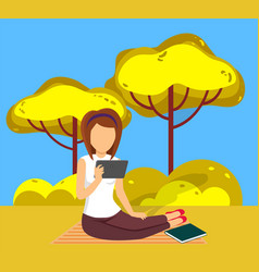 woman reading literature in park sitting on ground vector image