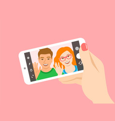 young couple takes a selfie with a smartphone vector image