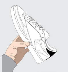 the woman is catching her white shoes vector image