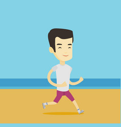 young sporty man jogging on the beach vector image