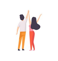 Girl and guy standing with hands raised back view vector