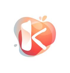 K letter logo at colorful watercolor splash vector