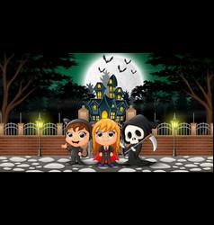 Happy halloween group celebrate in front of haunte vector