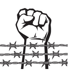 Raised hand with clenched fist behind barbed wire vector