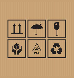 Packaging symbols set on cardboard background vector