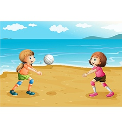 Girls playing volleyball at the beach vector image