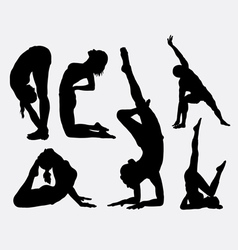 Male and female yoga silhouettes vector