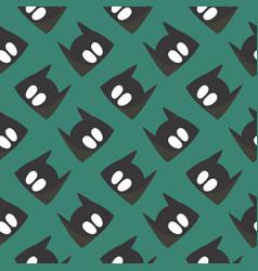 Batman mask seamless pattern on a green vector