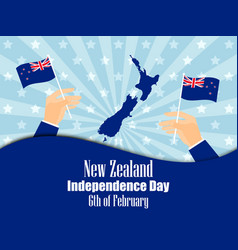 Hand holds a new zealand flag independence day vector