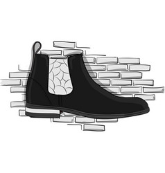 Chelseablack boots on a light gray brick wall vector