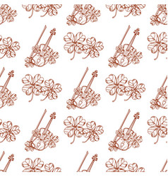 seamless pattern with violin and leaf clover vector image